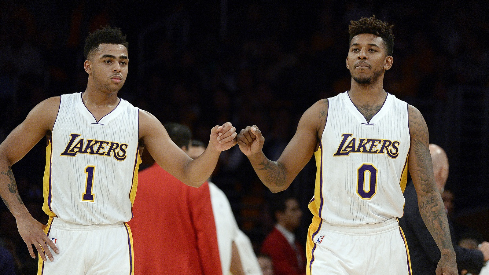LOS ANGELES, CA - NOVEMBER 22: D'Angelo Russell #1 and Nick Young #0 of the Los Angeles Lakers pump fists during the second half of the basketball game against Portland Trail Blazers at Staples Center November 22, 2015 in Los Angeles, California. NOTE TO USER: User expressly acknowledges and agrees that, by downloading and or using the photograph, User is consenting to the terms and conditions of the Getty Images License Agreement. (Photo by Kevork Djansezian/Getty Images)