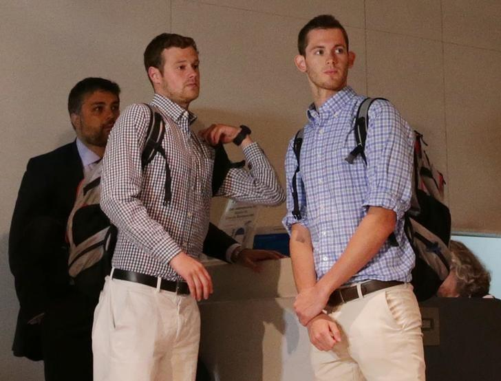 U.S. Olympic swimmers Jack Conger and Gunnar Bentz check in at the international airport to board a flight back to the U.S. after spending the day being interrogated by police in Rio de Janeiro, August 18, 2016. REUTERS/Ueslei Marcelino